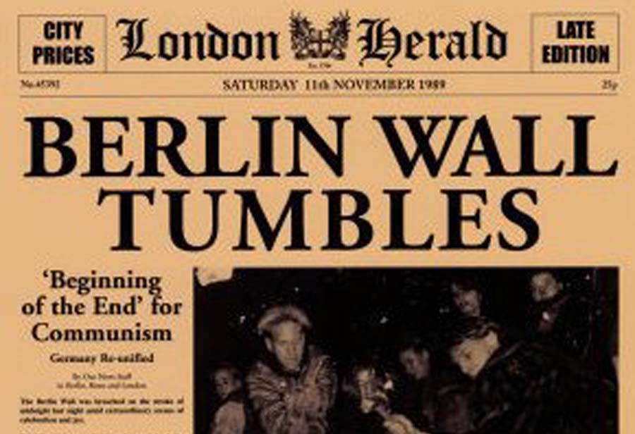 https://travelersunited.org/wp-content/uploads/BerlinWall-Newspaper.jpg